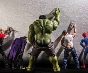 Superhero Figures Arranged In Humorous Scenarios