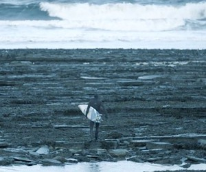 Mark Boyd surfs in the cold waves of Scotland